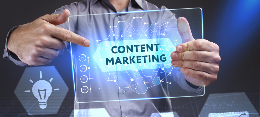 Business man holding tablet that says 'content marketing'