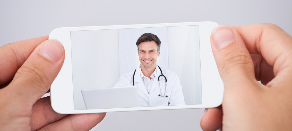 mobile phone featuring video of physician speaking to attract new patients for healthcare business