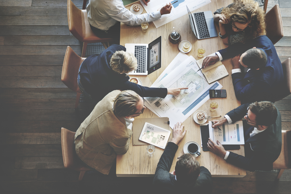 Content marketers planning their content strategy at conference table