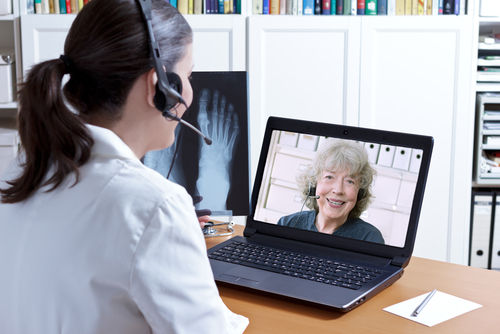 Female doctor teleconferencing with a patient