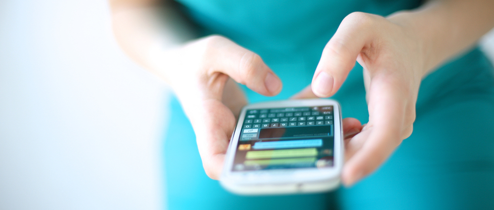Healthcare professional using a messaging platform on mobile device