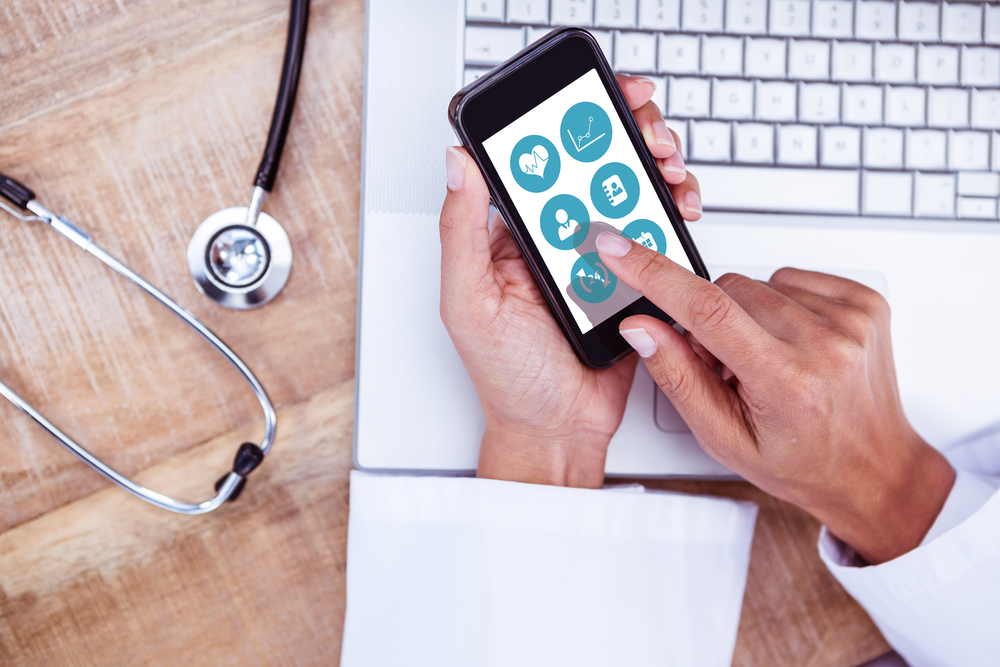 Healthcare professional accessing a health app on their mobile device