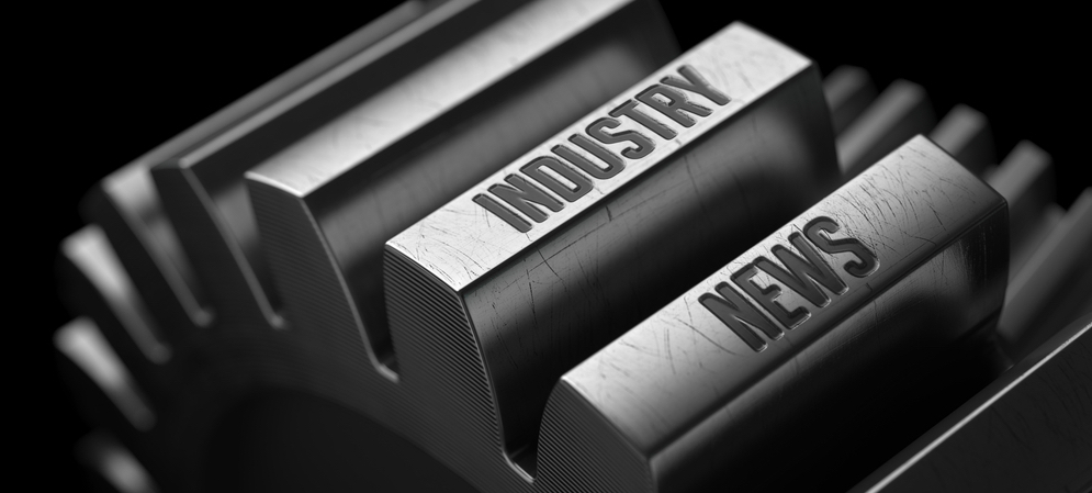 """Steel wheel imprinted with the words """"Industry"""" and """"News"""""""