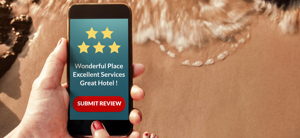 Person submitting a hotel review via smartphone.