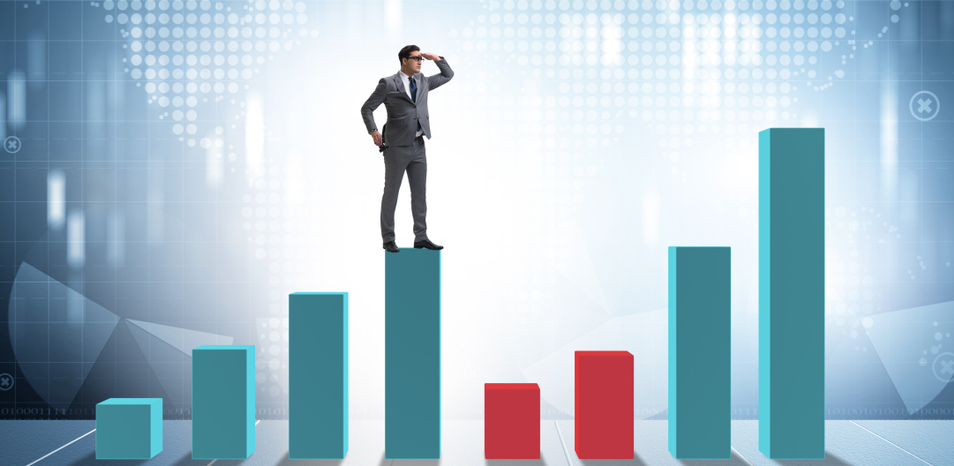 Man standing on top of a bar graph analyzing the points.