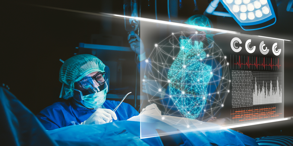 A surgeon inspecting his patient's heart status displayed on a screen