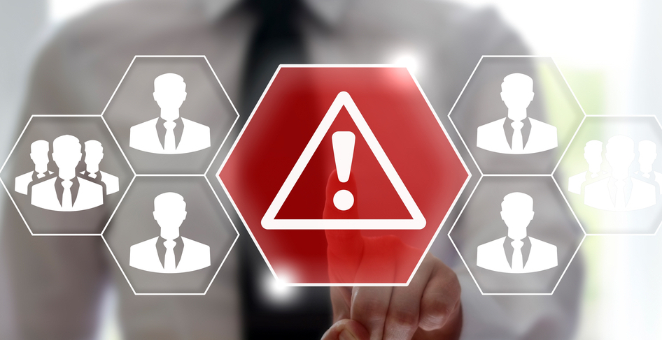 Hexagonal images with the icon of a businessman in them and a caution symbol.