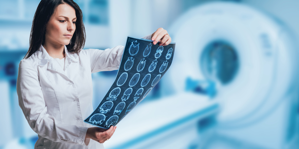 Female doctor looking at the results of an MRI.