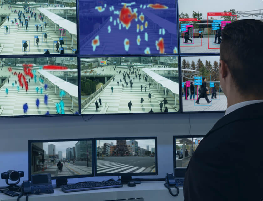 Man looking at surveillance cameras