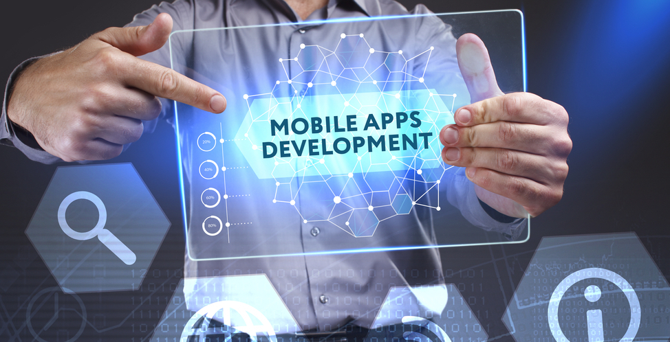 "Man pointing at a table displaying the words ""Mobile app development"""