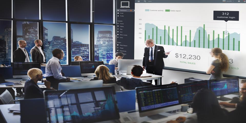 Team of business leaders looking at a financial chart