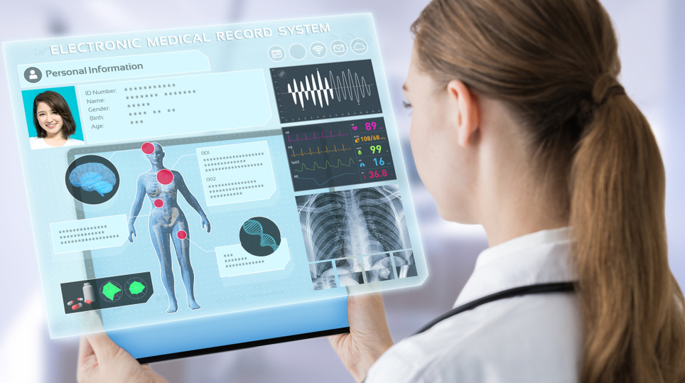 Female doctor looking at an electronic medical record system on a tablet