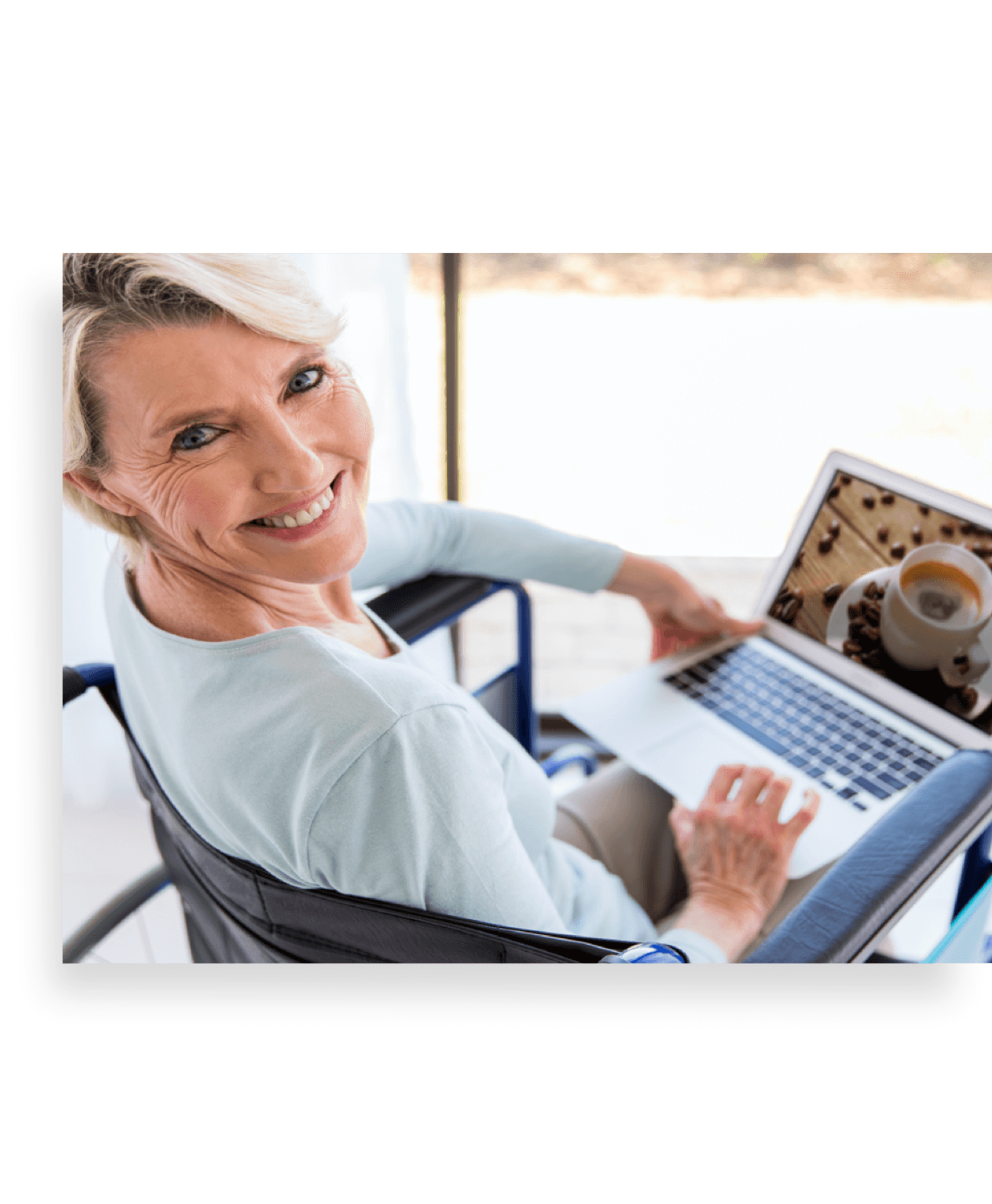 Photo of woman in a wheelchair browsing a website