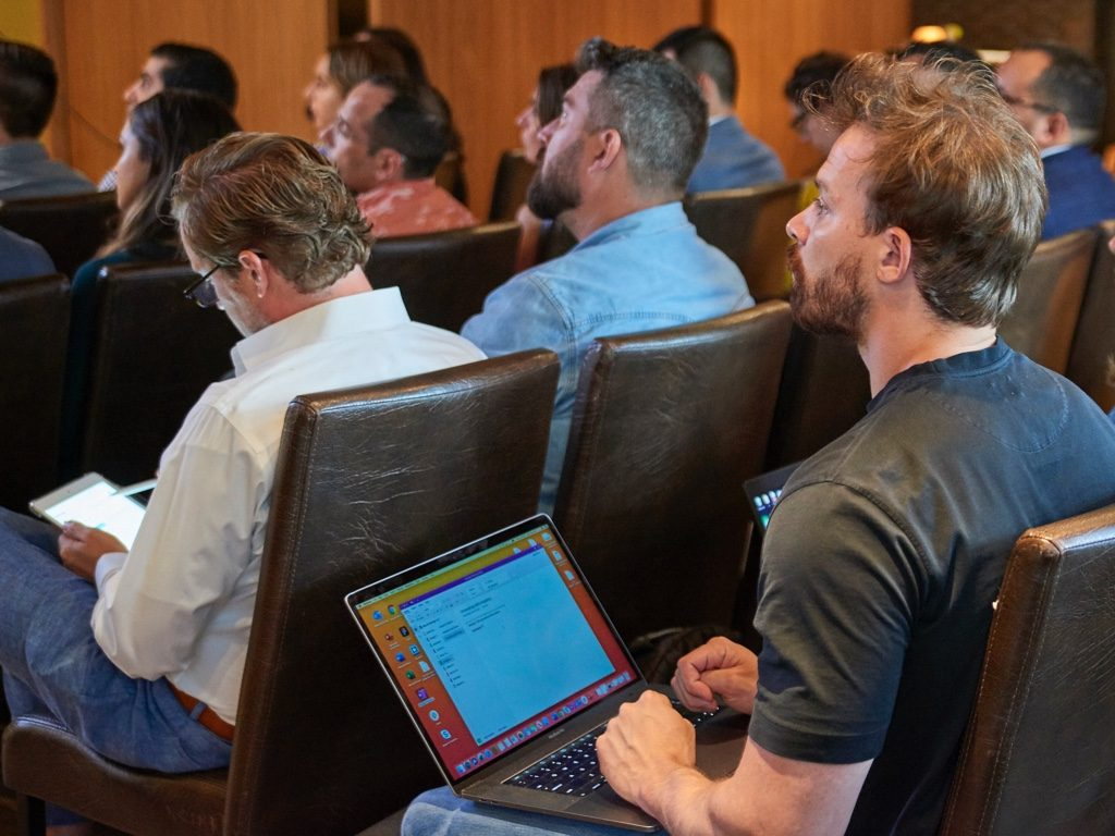 Man in the audience during a Digital Authority analytics event